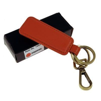 מחזיק מפתחות מעור אמיתי דגם בוס, ניתן להטביע שורה אחת בלבד כתום